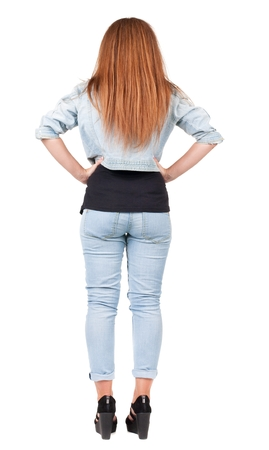 back view of standing young beautiful redhead woman. girl  watching. Rear view people collection.  backside view of person.  Isolated over white background.