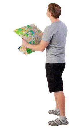 Back view of  journey  young man looking at the map. travelers man in shorts consider recreation. Rear view people collection.  backside view of person.  Isolated over white background. Stock Photo