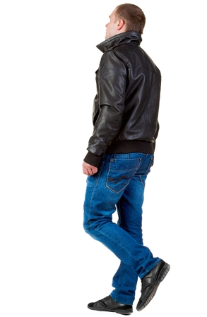 treading: Back view of going  handsome man in jeans and jacket.  walking young guy in jeans and  jacket. Rear view people collection.  backside view of person.  Isolated over white background. Stock Photo