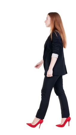 businesswoman suit: walking red head business woman. back view. going young girl in  suit. Rear view people collection.  back side view of person.  Isolated over white background.