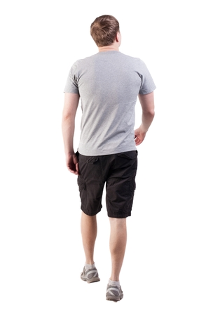 Back view of walking handsome man in shorts and sneakers.   Sports-dressed young man moves. going young guy. Rear view people collection.  backside view of person.  Isolated over white background. broad-shouldered guy is looking forward to the left