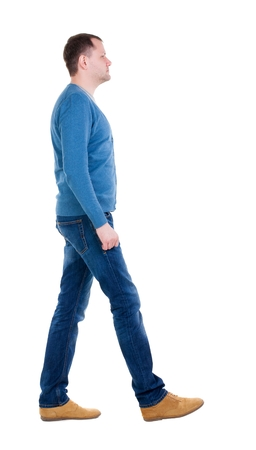 Back view of going  handsome man in blue pullover. walking young guy . Rear view people collection.  backside view of person.  Isolated over white background. Stock Photo