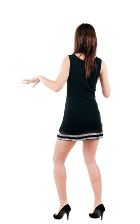 Young woman dancing. backside view of person. Isolated over white background. Rear view people collection. Stock Photo