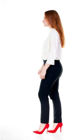 walking redhead business woman. back view. going young girl in  suit. Rear view people collection.  back side view of person.  Isolated over white background. Stock Photo