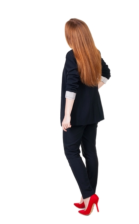 businesswoman suit: back view of redhead business woman contemplating. Young girl in suit.  Rear view people collection.  backside view of person.  Isolated over white background.