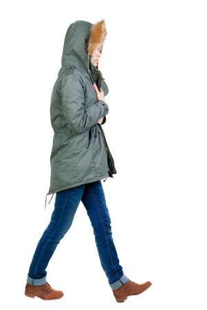 warm jacket: back view of walking  woman in warm jacket. beautiful brunette girl in motion.  backside view of person.  Rear view people collection. Isolated over white background. Stock Photo