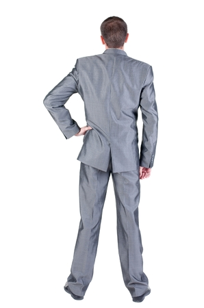 Businessman  looks ahead. rear view. Isolated over white Stock Photo