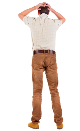 desilusion: Back view of angry young man in jeans and shirt. Rear view. isolated over white. backside view of person.  Rear view people collection. Isolated over white background.