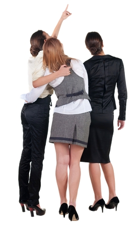 3 persons only: back view of business team. three young  woman pointing.  Rear view people collection.  backside view of person.  Isolated over white background. Stock Photo