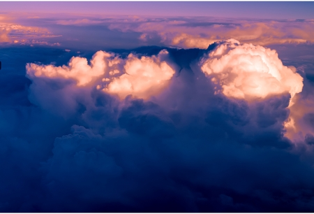 Clouds. bright morning dawn in the sky. sunset with a height of 10 000 km. Top view. night and day. the setting sun sunset light illuminates the upper cloud layers Stock Photo