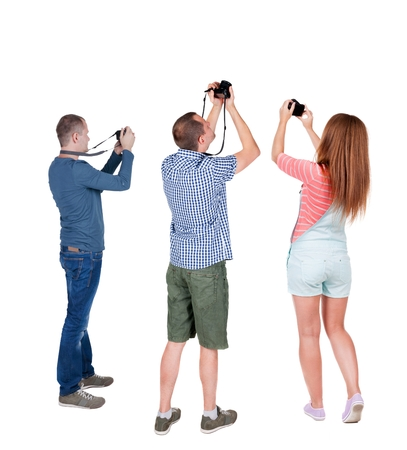 observers: Back view group of people photographed attractions. Rear view team people collection.  backside view of person.  Isolated over white background. Stock Photo