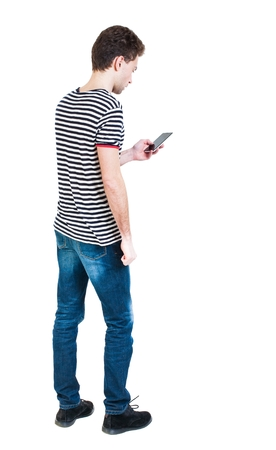 back view of man in suit  talking on mobile phone.    rear view people collection. Isolated over white background. backside view of person. The guy in the striped shirt looking at the cell phone. Banco de Imagens