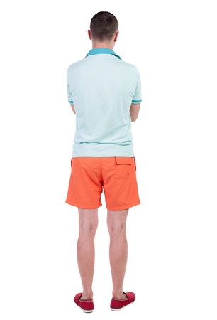 Back view of handsome man in shorts. Rear view people collection.  backside view of person.  Isolated over white background. Stock Photo