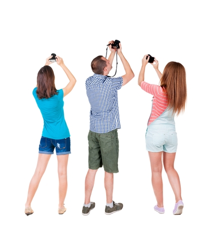 Back view group of people photographed attractions. Rear view team people collection.  backside view of person.  Isolated over white background. Stock Photo