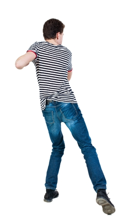 back view of skinny guy funny fights waving his arms and legs. Isolated over white background. Rear view people collection.  backside view of person. Funny guy clumsily boxing. The guy in the striped shirt in the backswing.