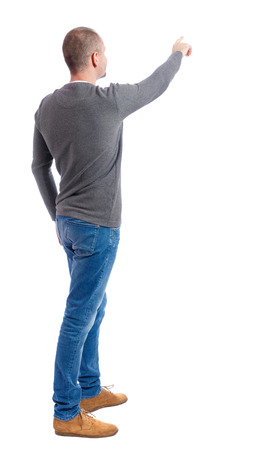 Back view of  pointing young men in  shirt and jeans. Young guy  gesture. Rear view people collection.  backside view of person.  Isolated over white background. A guy in a gray sweater shows finger forward.