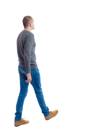 Back view of going  handsome man. walking young guy . Rear view people collection.  backside view of person.  Isolated over white background. A guy in a gray sweater passes.