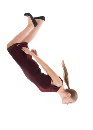 Balancing young woman.  or dodge falling woman. Rear view people collection.  backside view of person.  Isolated over white background. A girl in a burgundy dress falls head down.
