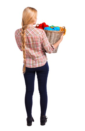 Back view of woman with  basket of dirty laundry. girl is engaged in washing. Rear view people collection.  backside view of person.  Isolated over white background. Girl with very long hair holding a basket