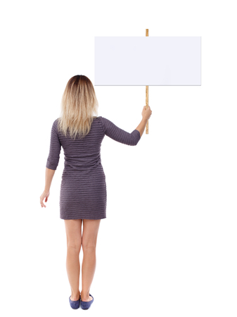 Back view woman showing sign board. man holds information plate. Rear view people collection. backside view of person. Isolated over white background.  The girl in the brown dress poster raised above his head.