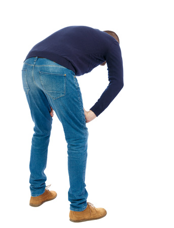standing up: Back view of a man who rests in his hands leaning. Standing young guy. Rear view people collection.  backside view of person.  Isolated over white background.  Man in warm jacket bent wearily.
