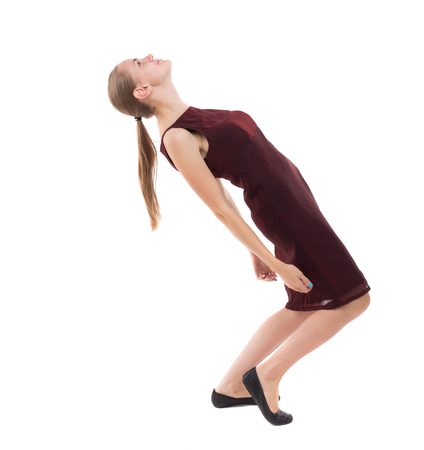 girl in burgundy dress: Balancing young woman.  or dodge falling woman. Rear view people collection.  backside view of person.  Isolated over white background. A girl in a burgundy dress falls on his back.