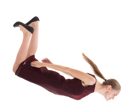 girl in burgundy dress: floating in the air woman.  or dodge falling woman. Rear view people collection.  backside view of person.  Isolated over white background. A girl in a burgundy dress falls down.