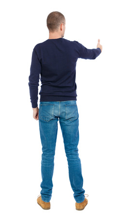 warm shirt: Back view of  man in shirt shows thumbs up.   Rear view people collection.  backside view of person.  Isolated over white background. Man in warm jacket stretched out his hand forward.