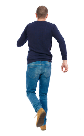 Back view of going  handsome man. walking young guy . Rear view people collection.  backside view of person.  Isolated over white background. Man in warm jacket runs off into the distance.