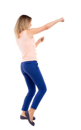 wimp: skinny woman funny fights waving his arms and legs. Isolated over white background. The blonde in a pink shirt boxing