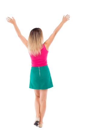 Back view of  business woman.  Raised his fist up in victory sign.    Raised his fist up in victory sign.  Rear view people collection.  backside view of person.  Isolated over white background. Girl in a green skirt lifted her arms up.
