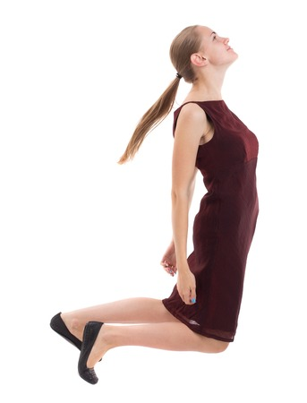 girl in burgundy dress: floating in the air woman.  or dodge falling woman. Rear view people collection.  backside view of person.  Isolated over white background. A girl in a burgundy dress slipped. Stock Photo