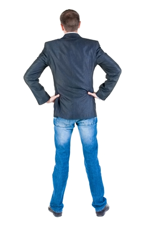 young expert looks ahead. rear view. Isolated over white . Stock Photo