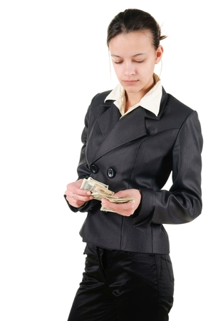 Young businesswoman counts money. Isolated over white.
