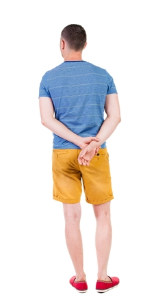 backside: Back view of handsome man in shorts. Rear view people collection.  backside view of person.  Isolated over white background. Stock Photo