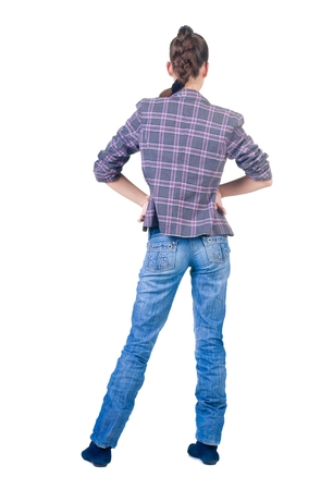 specifies: Beautiful young brunette in  checkered jacket looks in  distance. Rear view.Isolated over white.