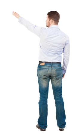 powerfully: Back view of pointing business man. gesticulating young guy in black suit. Rear view people collection.  backside view of person.  Isolated over white background. office worker in a shirt and trousers powerfully indicates something Side. The bearded man w