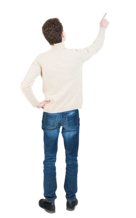 powerfully: Back view of pointing business man. gesticulating young guy in black suit. Rear view people collection.  backside view of person.  Isolated over white background. office worker in a shirt and trousers powerfully indicates something Side A man shows and te