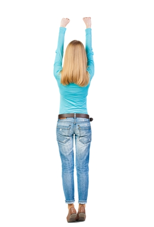 pulled over: Back view of  woman.  Raised his fist up in victory sign.  Rear view people collection.  backside view of person.  Isolated over white background. she pulled up with two hands.