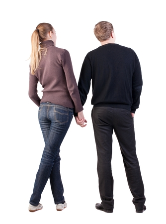 opinionated: Back view of young couple (man and woman) hug and look into the distance. beautiful friendly girl and guy together. Rear view. Isolated over white background.  opinionated pair of newlyweds interested considering something right