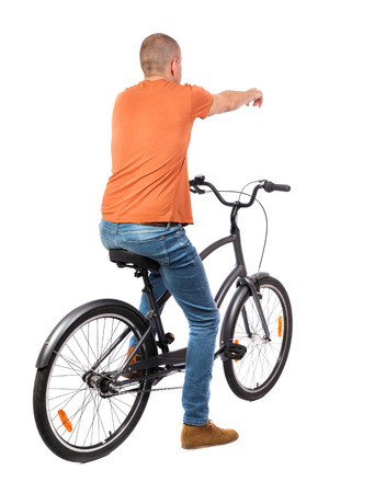 back view of pointing man with a bicycle. cyclist sits on the bike.  Rear view people collection.  backside view of person. Isolated over white background. photo