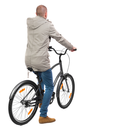 back view of a man with a bicycle. cyclist sits on the bike. Rear view people collection.  backside view of person. Isolated over white background. photo