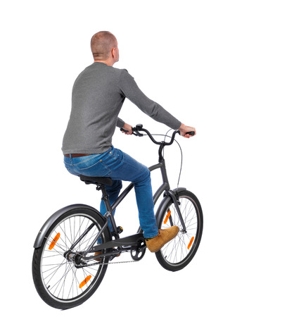 back view of a man with a bicycle. cyclist rides a bicycle. Rear view people collection.  backside view of person. Isolated over white background. photo