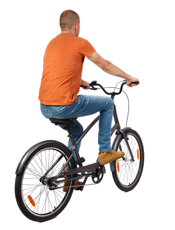 back view of a man with a bicycle. cyclist rides a bicycle. Rear view people collection.  backside view of person. Isolated over white background. Bald man is leaving on bicycles chopper.