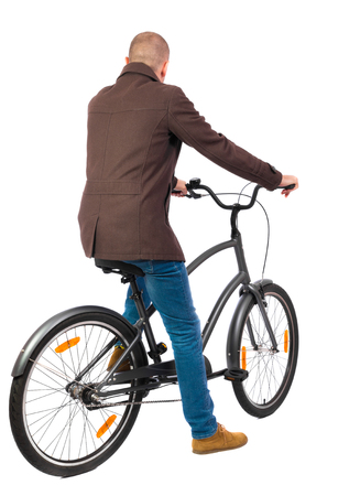 back view of a man with a bicycle. cyclist sits on the bike. Rear view people collection.  backside view of person. Isolated over white background. Shorthair guy in the coat led bike