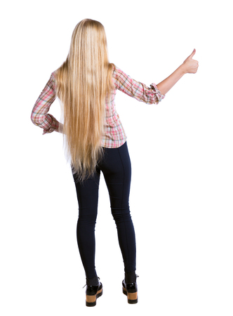 Back view of  woman thumbs up. Rear view people collection. backside view of person. Isolated over white background. Long-haired girl shows thumbs up. Stock Photo