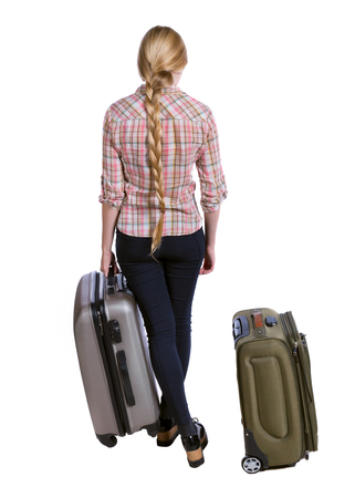 Back view of woman with suitcase looking up. Standing young girl. Rear view people collection.  backside view of person. Isolated over white background. Long-haired girl standing with suitcases. Stock Photo