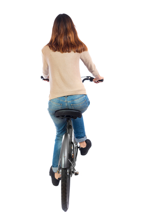 back view of a woman with a bicycle. cyclist sits on the bike. Rear view people collection.  backside view of person. Isolated over white background. Brunette pedaling a bicycle. photo