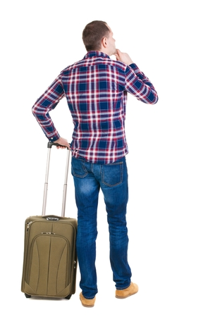 Back view of man with  green suitcase looking up. Rear view people collection.  backside view of person.  Isolated over white background.