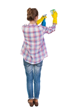 Back view of a housewife in gloves with sponge and detergent. girl  watching. Rear view people collection.  backside view of person.  Isolated over white background. The young girl engaged in cleaning.
